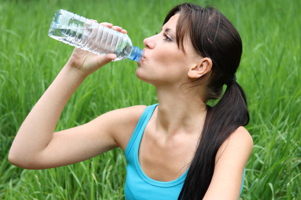 woman-drinking-water-outside